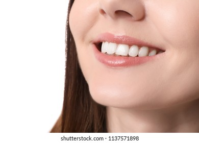 Beautiful young woman with healthy teeth on white background