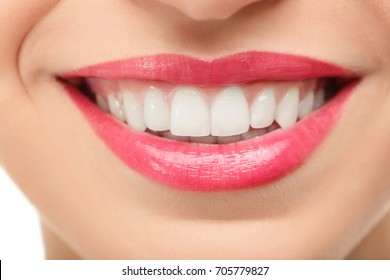 Beautiful young woman with healthy teeth, close up