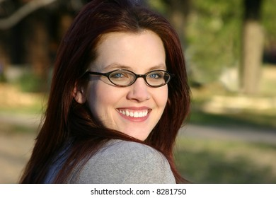Beautiful young woman in her twenties smiling.