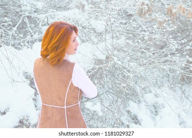 Beautiful Young woman in her Winter Warm Clothing.