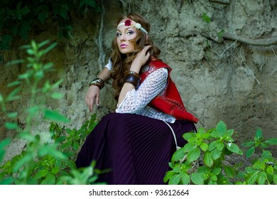 beautiful young woman hippie in a forest