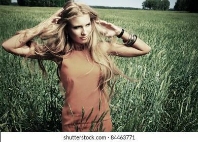 Beautiful young woman hippie posing outdoor.
