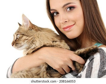 Beautiful young woman holding cat isolated on white