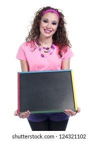 Beautiful young woman holding chalkboard over white background