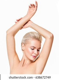 Beautiful young woman holding her arms up and showing clean underarms. Armpit's care. Armpit epilation, hair removal, perfect skin.