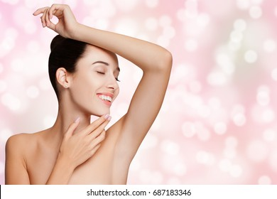 Beautiful young Woman Holding her Arms up and Showing Clean Underarms. Armpit's Care. Armpit Epilation, Hair Removal, Perfect Skin