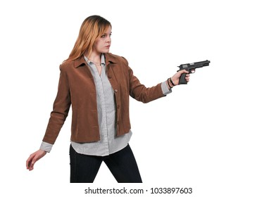 Beautiful young woman holding a loaded handgun