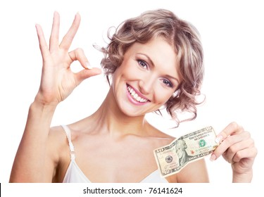 beautiful young  woman holding money and showing us the sign OK