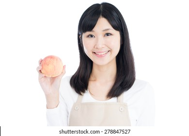 beautiful young woman holding peach, isolated on white background