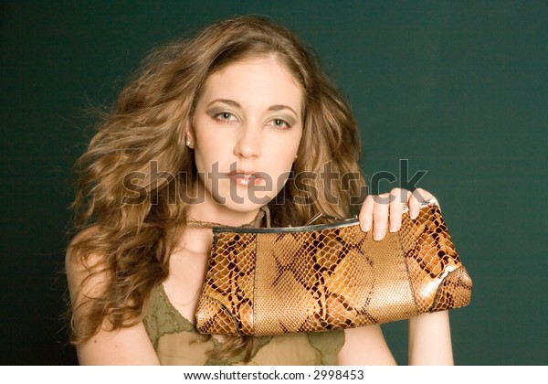 Beautiful young woman holding a purse