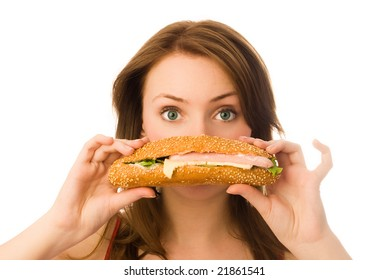 beautiful young woman with a hot-dog isolated against white background