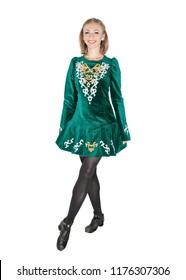 Beautiful young woman in Irish dance green dress isolated on white