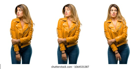 Beautiful young woman irritated and angry expressing negative emotion, annoyed with someone over white background