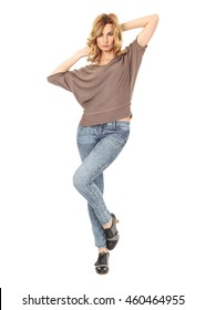 Beautiful young woman in jeans isolated on white background