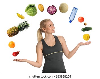 Beautiful young woman juggling fruits, vegetables and bottled water isolated over white background