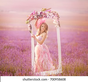 Beautiful young woman in the lavender fields. Pink skirt , a good mood . Provence .