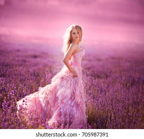 Beautiful young woman in the lavender fields. Pink skirt , a good mood . Provence
