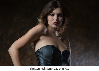 Beautiful young woman in leather corset