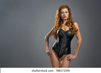 beautiful young woman in a leather fetish dress