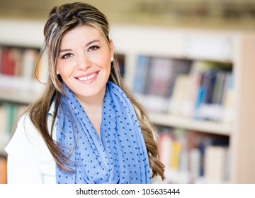 Beautiful young woman at the library smiling
