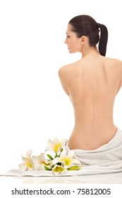 beautiful young woman with lily flowers, isolated on white, back view
