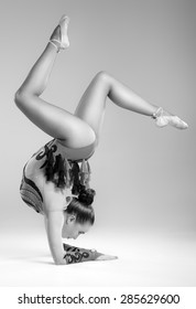 Beautiful young woman limber exerciser in the studio