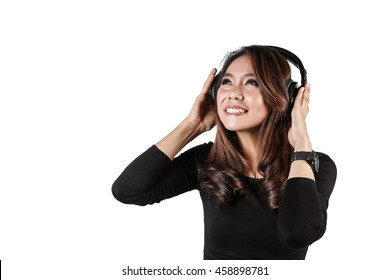 Beautiful young woman listening music in headphones on white background