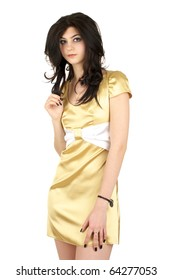 Beautiful young woman in little yellow silk dress isolated over white background