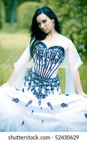 Beautiful young woman with long black hair and white dress