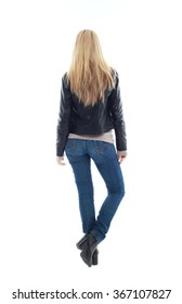 beautiful young woman with long blonde hair wearing black leather jacket and blue jeans.  standing pose, isolated on white background.