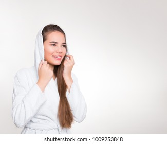 beautiful young woman with long hair wearing white bath robe
