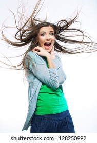Beautiful young woman with long  hair. Isolated female model. Blowing hair. Smiling happy girl.