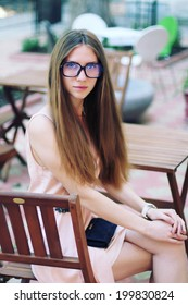 Beautiful young woman with long hair. Photo toned style Instagram filters