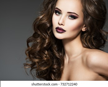 Beautiful young woman with long hair. Portrait of a amazing girl with style fashion makeup.