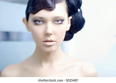 Beautiful young woman looking at the camera