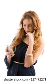 beautiful young woman looks in phone isolated on white background