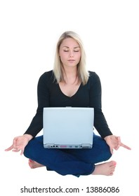 Beautiful young woman in lotus yoga position with laptop on lap.
