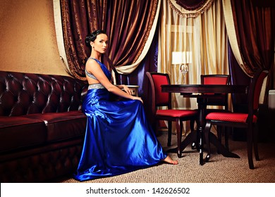 Beautiful young woman in a  luxurious classic interior.