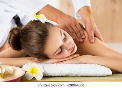 Beautiful young woman lying down at spa salon. Skin and body care, healthy lifestyle, relaxation, massage and cosmetology concept