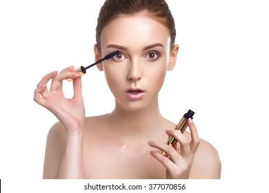 Beautiful Young Woman With Makeup Brush Applying Black Mascara On Eyelashes Isolated On White Background. Skin Care Theme