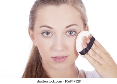 beautiful young woman with makeup powder blush isolated