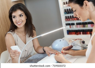 Beautiful young woman at manicurist.