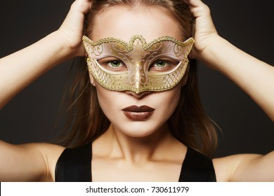 beautiful young woman in mask.Beauty model girl in Carnival Mask.Masquerade