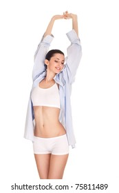 beautiful young woman in men's shirt stretching, isolated on white