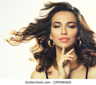 Beautiful young woman model with curly hairstyle wearing elegant jewelry