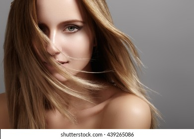 Beautiful young woman model with flying light color hair. Beauty portrait with clean skin, glamour fashion makeup. Make up, hairstyle. Haircare, make-up. Horizontal beauty portrait