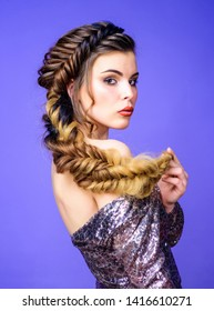 Beautiful young woman with modern hairstyle. Beauty salon hairdresser art. Girl makeup face braided long hair. French braid. Professional hair care and creating hairstyle. Braided hairstyle.