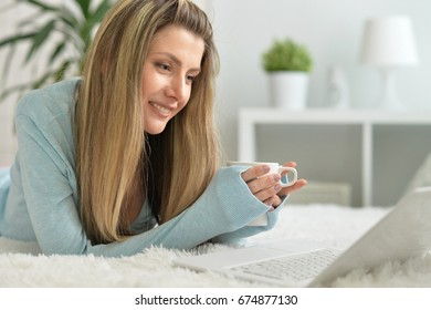 Beautiful young woman with modern laptop
