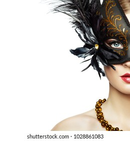 Beautiful young Woman in Mysterious Black Venetian Mask. Fashion photo. Masquerade Mask with Black Feathers