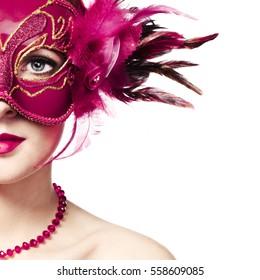 Beautiful young woman in mysterious golden Venetian mask. Fashion photo